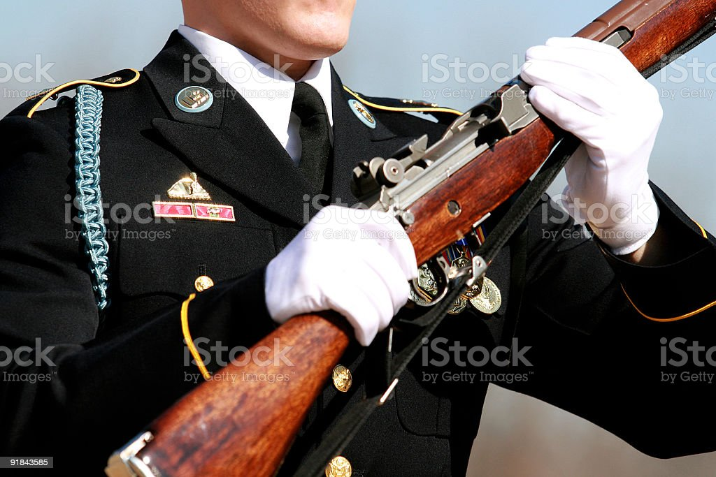 Honor guard in uniform holding a rifle stock photo