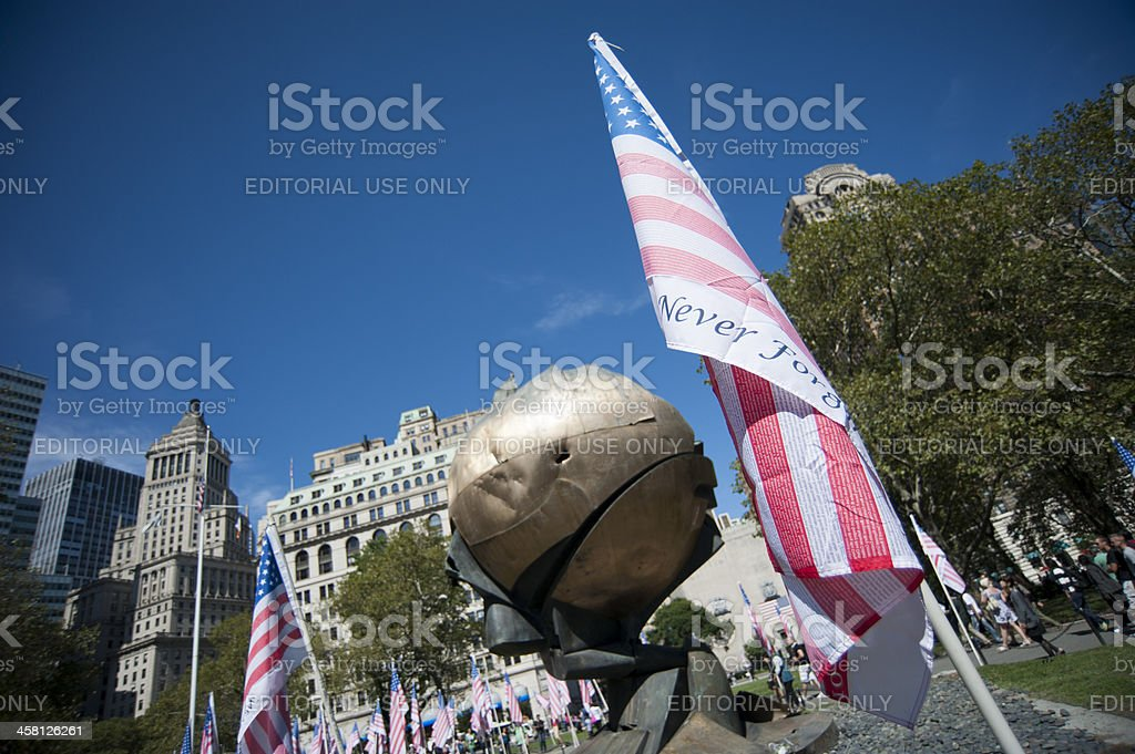 Honoring flag with sphere monument royalty-free stock photo