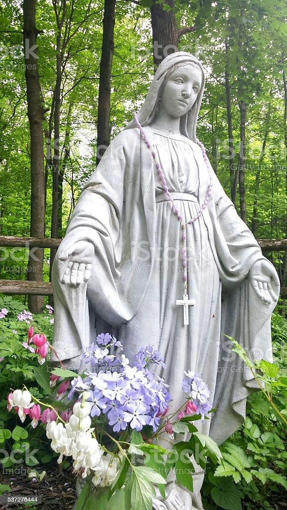 Honoring Virgin Mary Statue, Bleeding Hearts, Phlox Flowers, Garden, Forest stock photo
