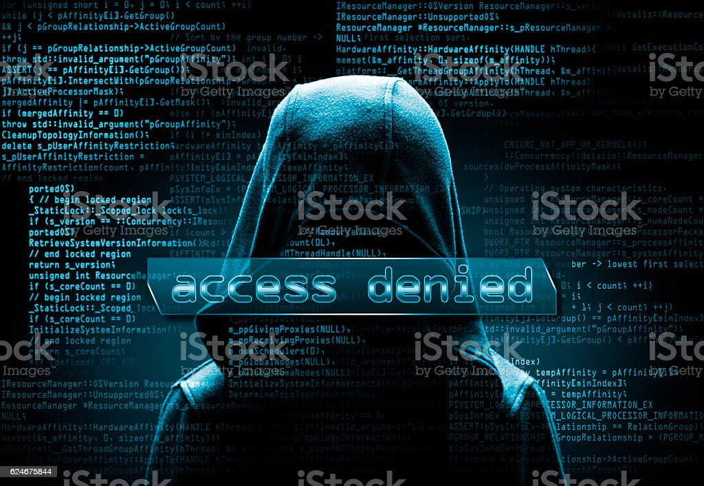 hooded computer hacker in the shadow with program codes stock photo