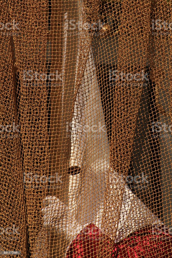 Hooded figure in a Spanish Easter Parade stock photo