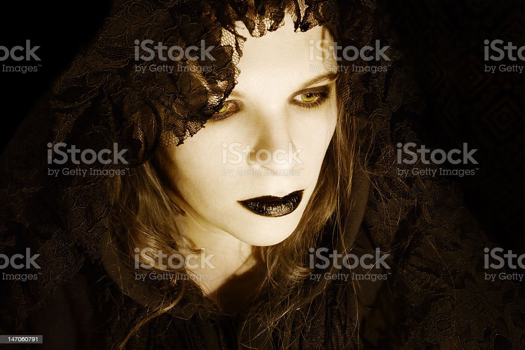 Hooded gothic woman stock photo