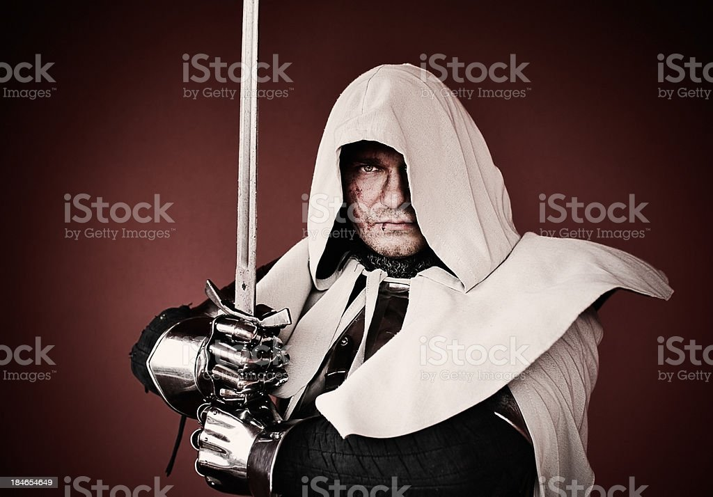 Hooded knight stock photo