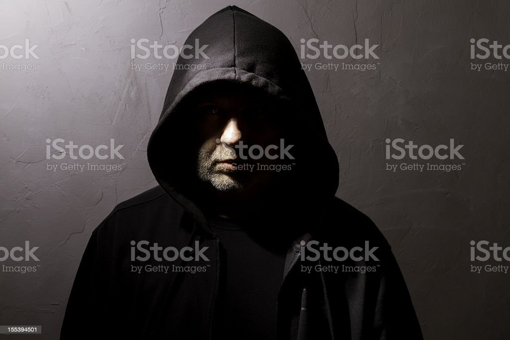 hooded man with hidden face royalty-free stock photo