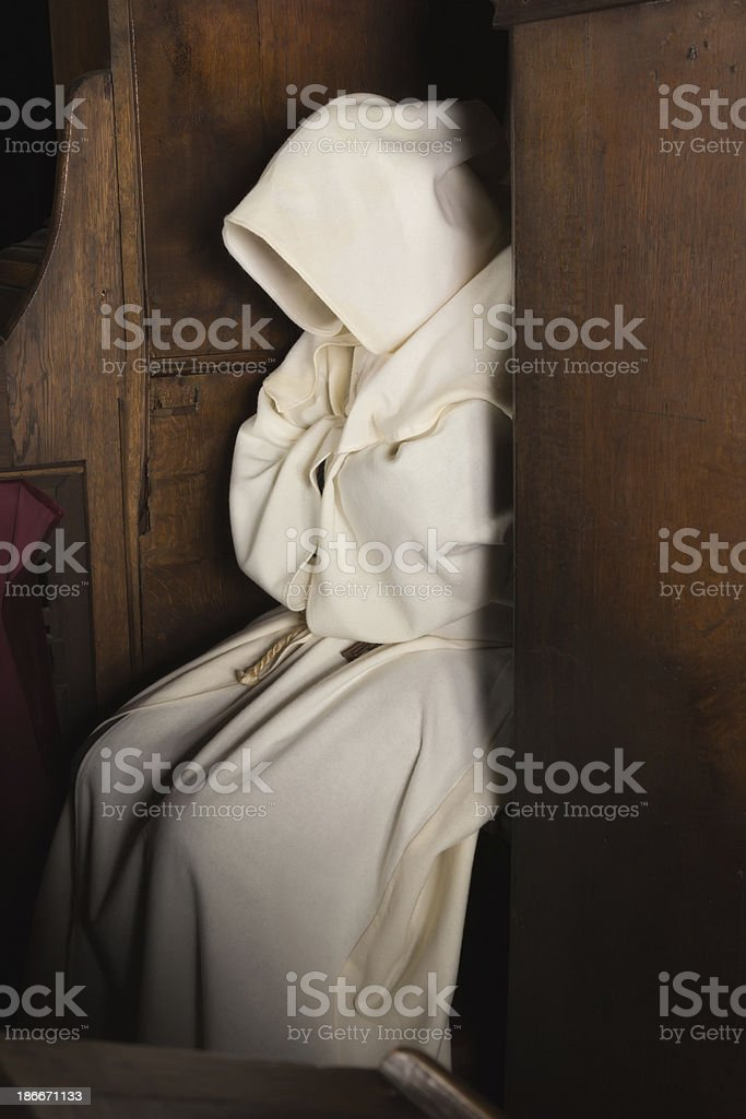 Hooded monk stock photo