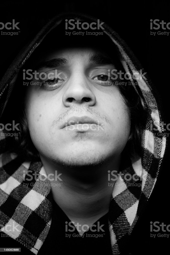 Hooded young man stock photo
