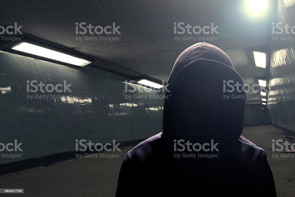 Hoodie gangster in subway (face in shadow) stock photo
