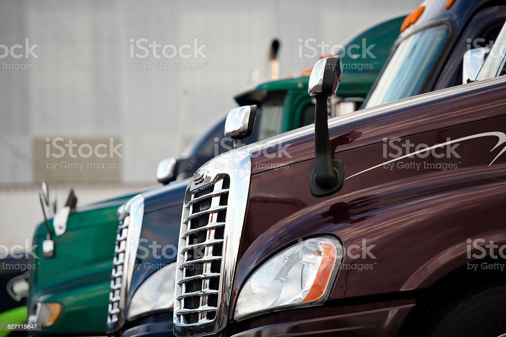 Hoods three semi trucks standing on truck stop stock photo