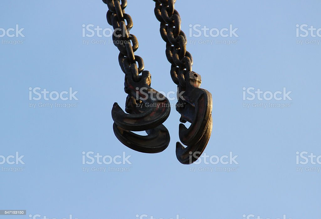 hook and boom lifting machinery at a construction site on stock photo