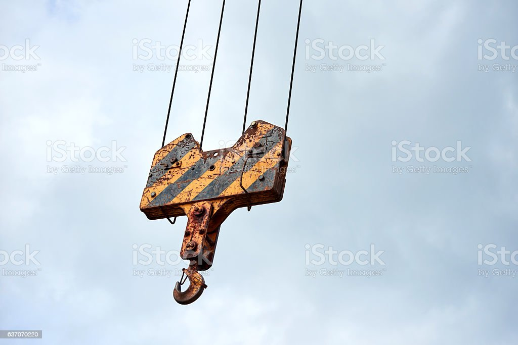 hook of crane on construction site stock photo