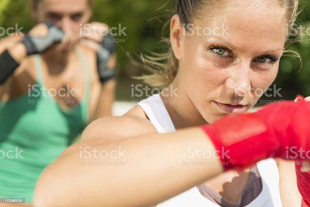 Hook punch - woman on tae bo training royalty-free stock photo