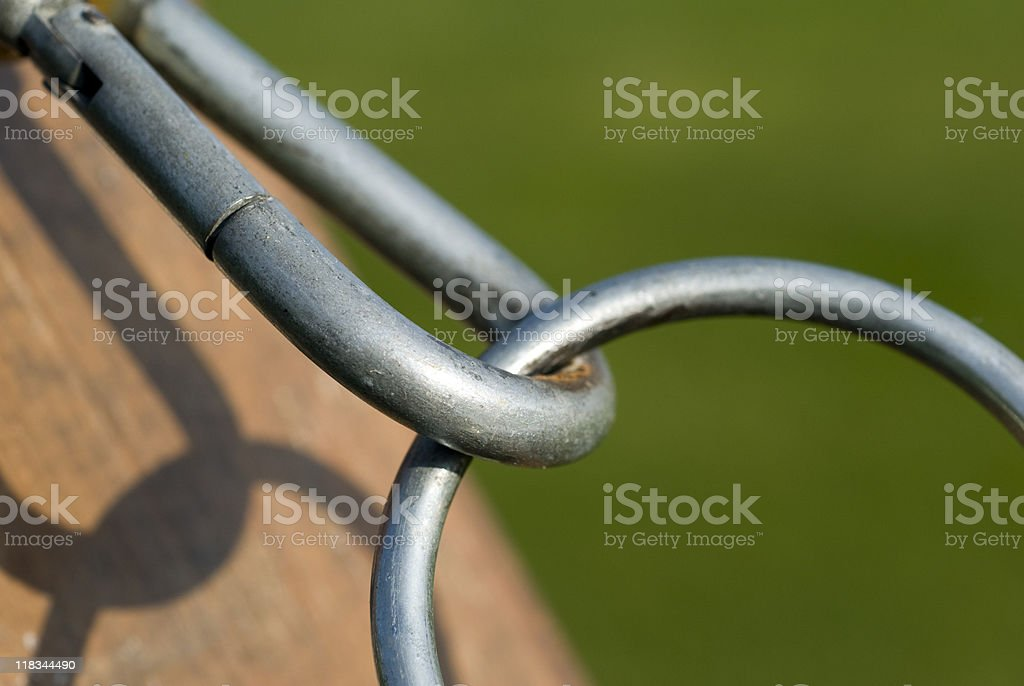 Hook with carabiner on wooden post, close-up royalty-free stock photo