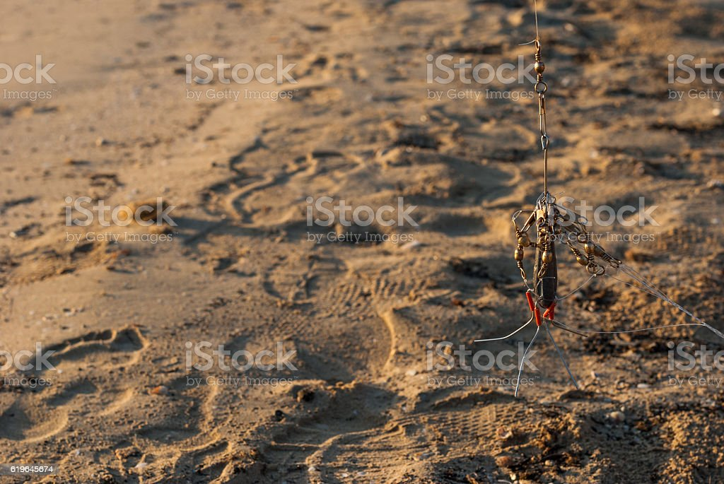Hook with sand on background stock photo