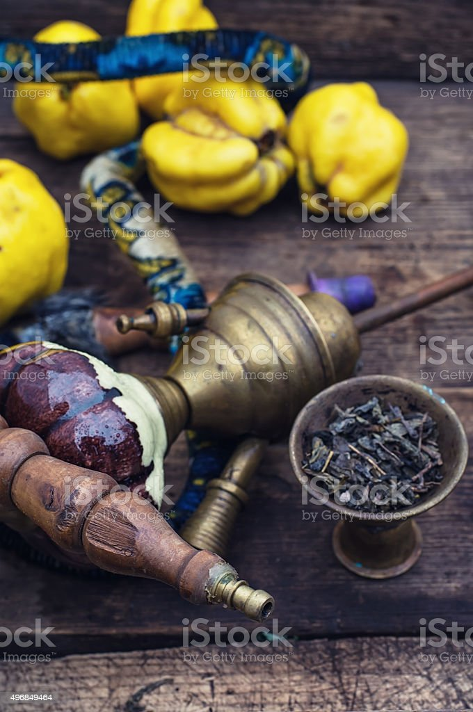 Hookah and quince. stock photo