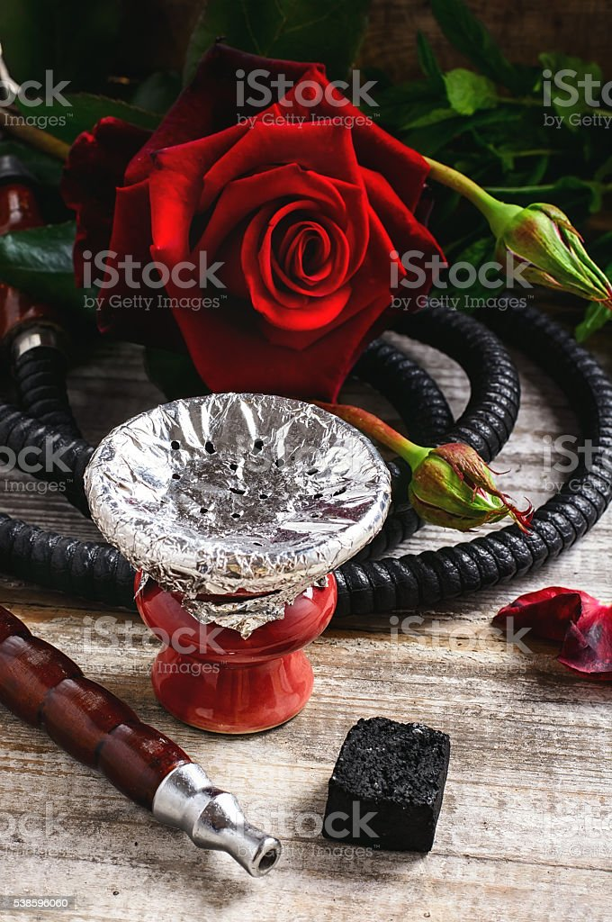 Hookah and red rose stock photo