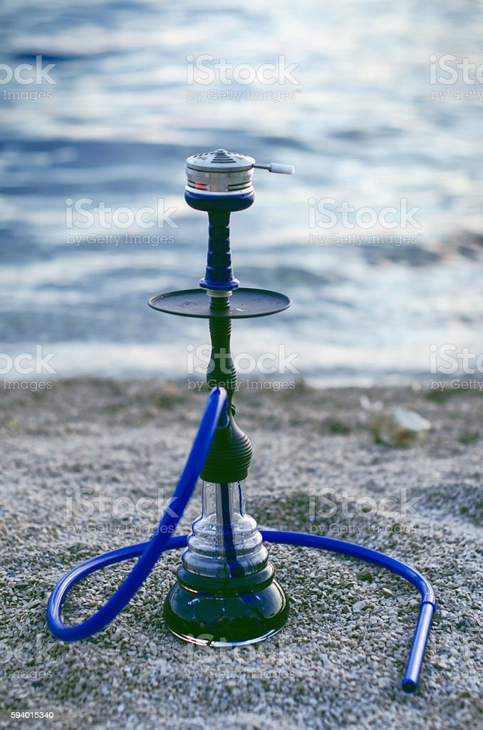 hookah and tabacoo. Smoking. Hookah on a beach. stock photo