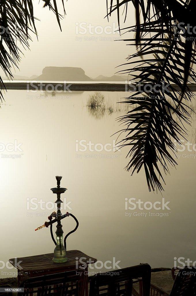 Hookah at sunset at Fatnas Spring, Siwa, Egypt stock photo