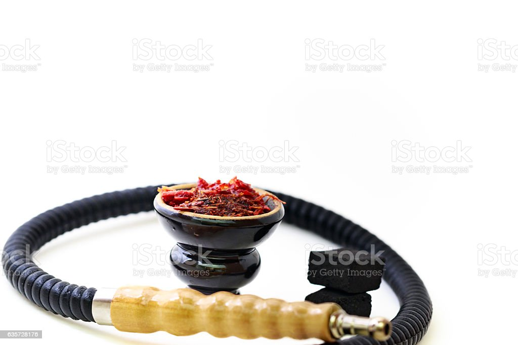 Hookah head, pipe, tobacco, and coals. stock photo