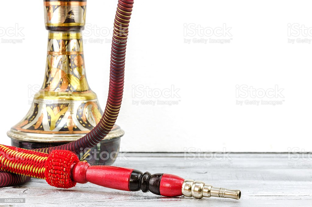 hookah or shisha is standing on a wooden table stock photo