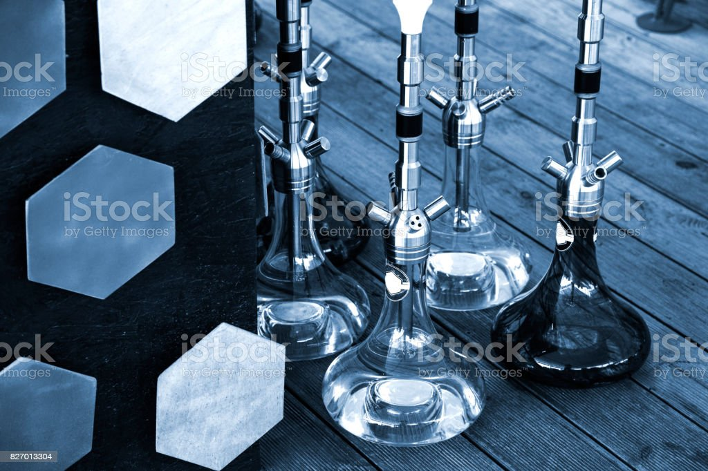 Hookahs and accessories in hookah cafe near the sea stock photo