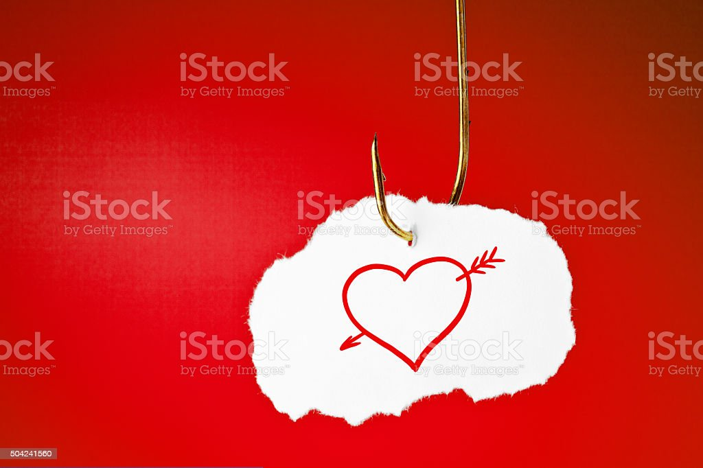 Hooked Heart with Arrow Concept stock photo