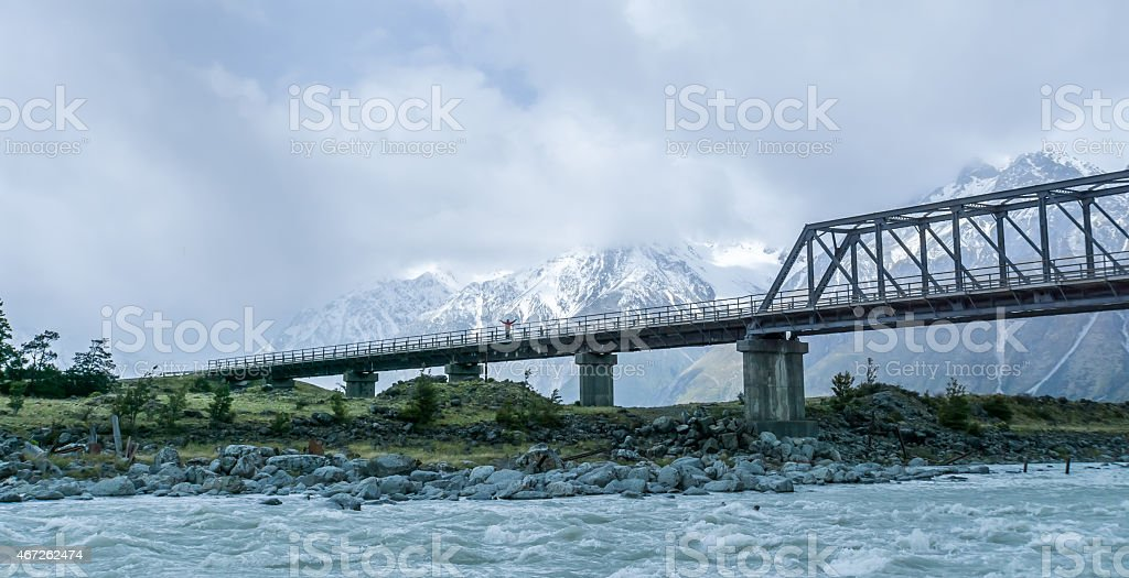 Hooker river and bridge in Mount Cook with one person stock photo