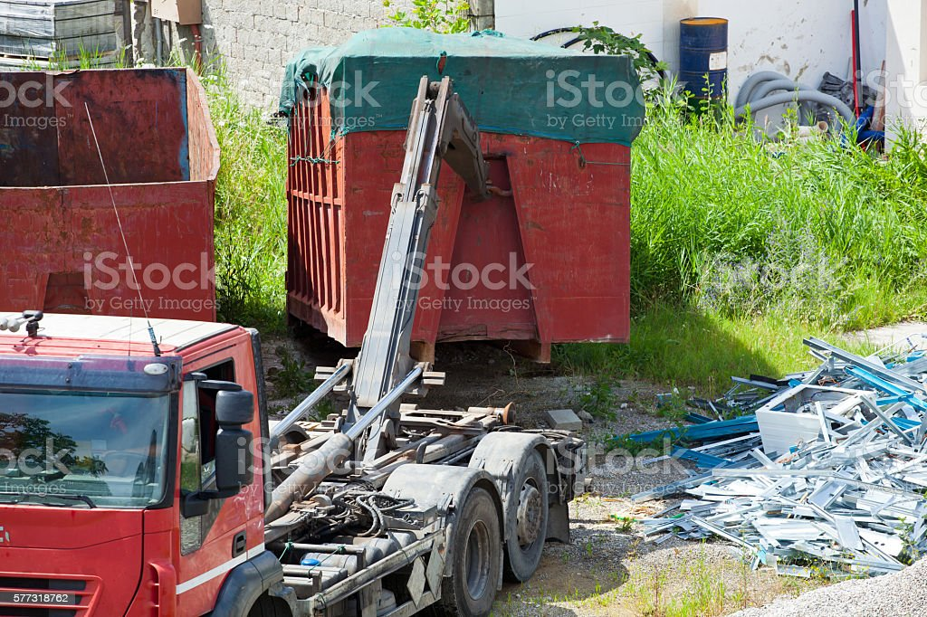 Hooking of a full container on the truck stock photo