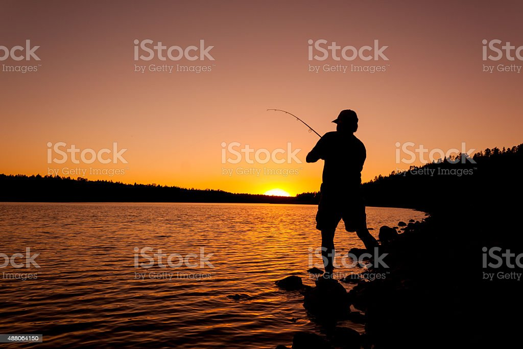 Hooking the Big One at Sunset stock photo