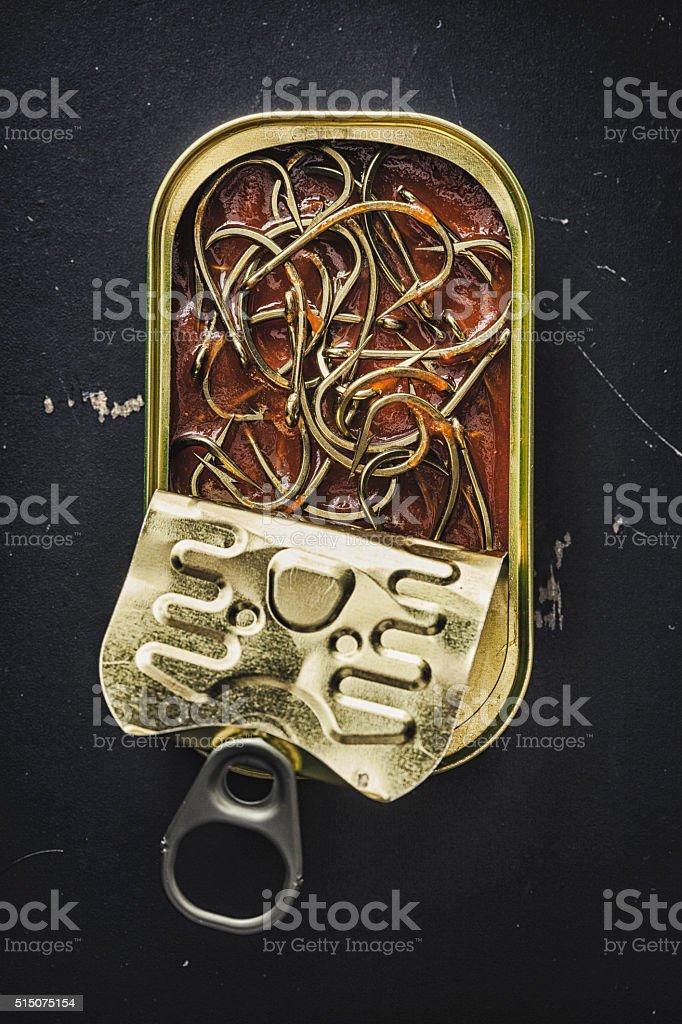 Hooks on tomato paste stock photo