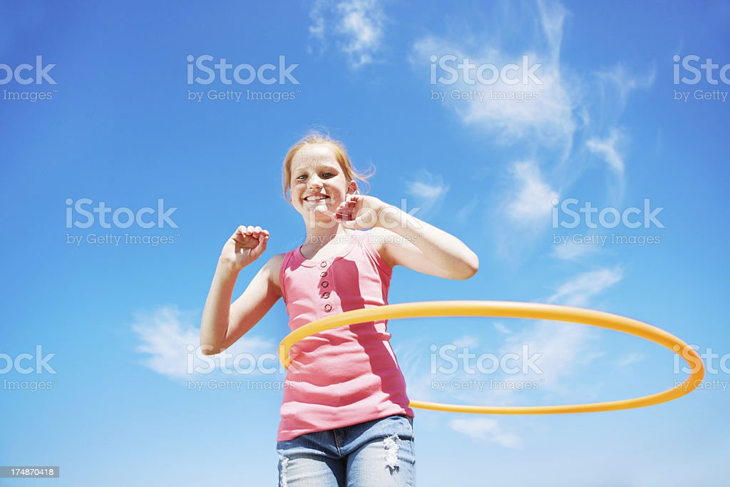 Hoolahooping and blue skies royalty-free stock photo