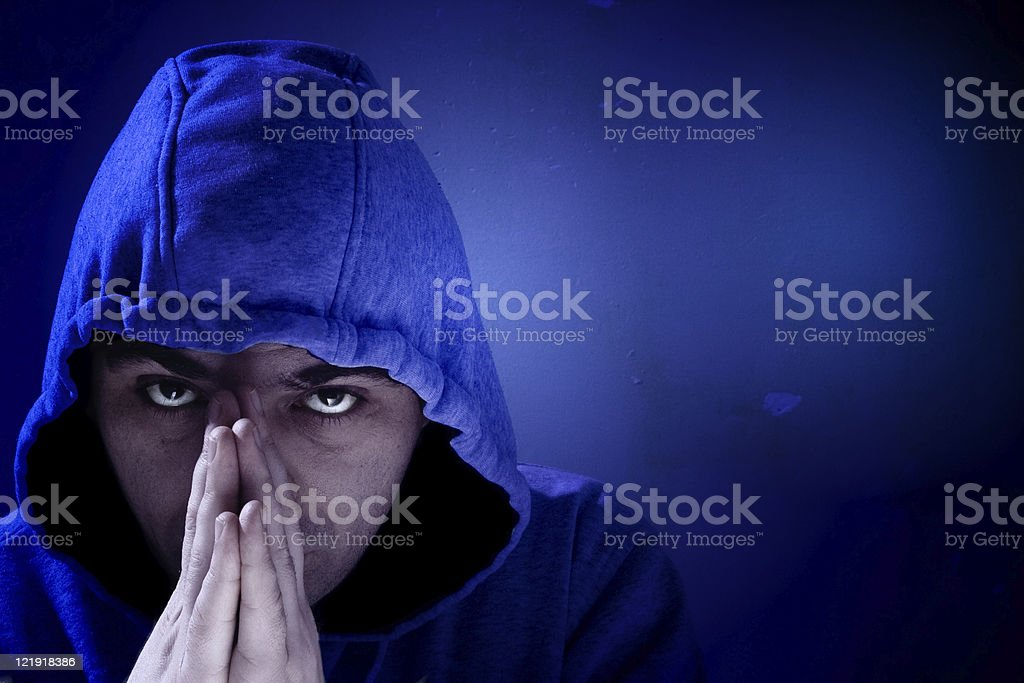 Hooligan praying stock photo