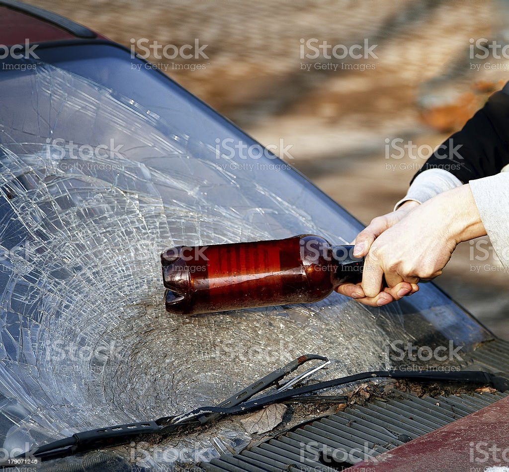 Hooligan smashing windshield royalty-free stock photo