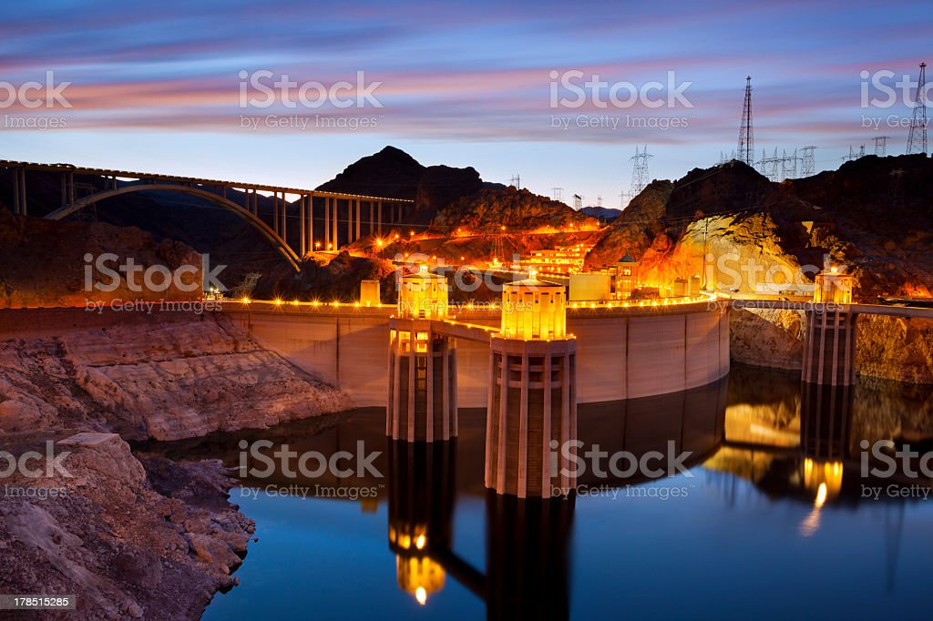 Hoover Dam lit up for the night during sunset stock photo