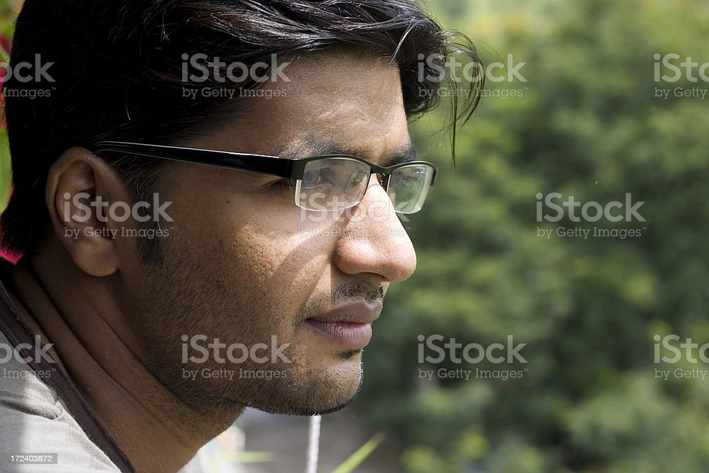 Hope Indian adult male thinking about future horizontal Natural Light stock photo