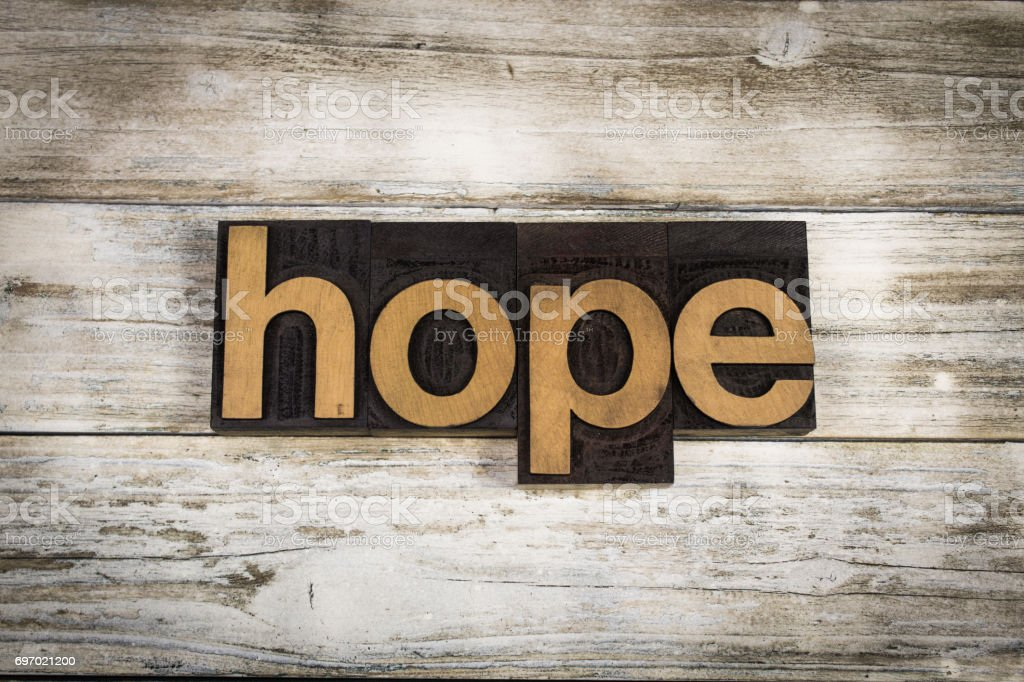 Hope Letterpress Word on Wooden Background stock photo