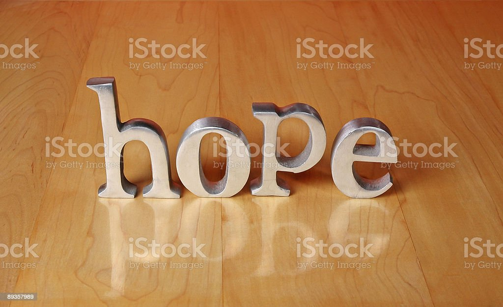 Hope Steel Letters on Maple Table royalty-free stock photo