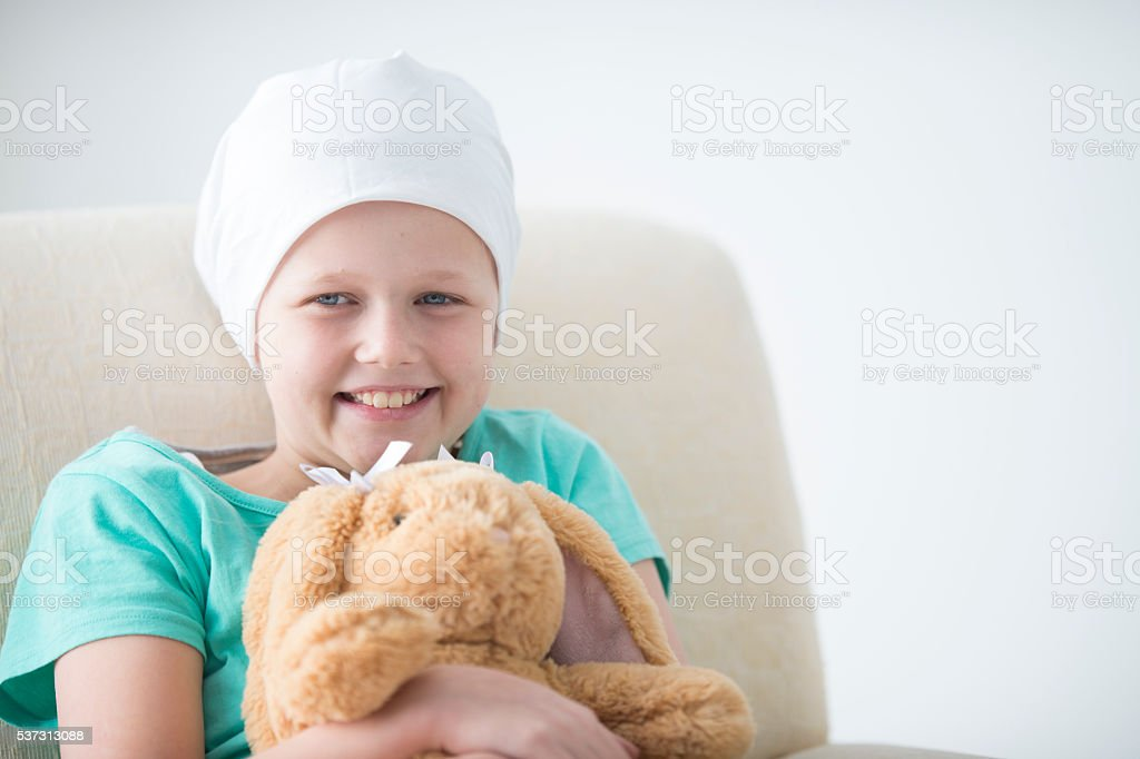 Hopeful and Happy Girl with Cancer stock photo