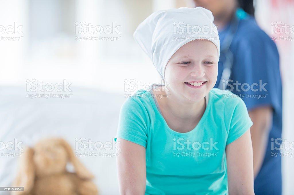 Hopeful Child with Cancer stock photo