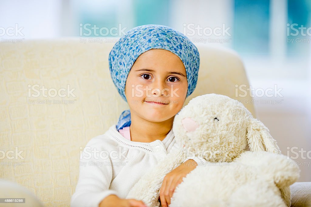 Hopeful Little Girl with Cancer stock photo