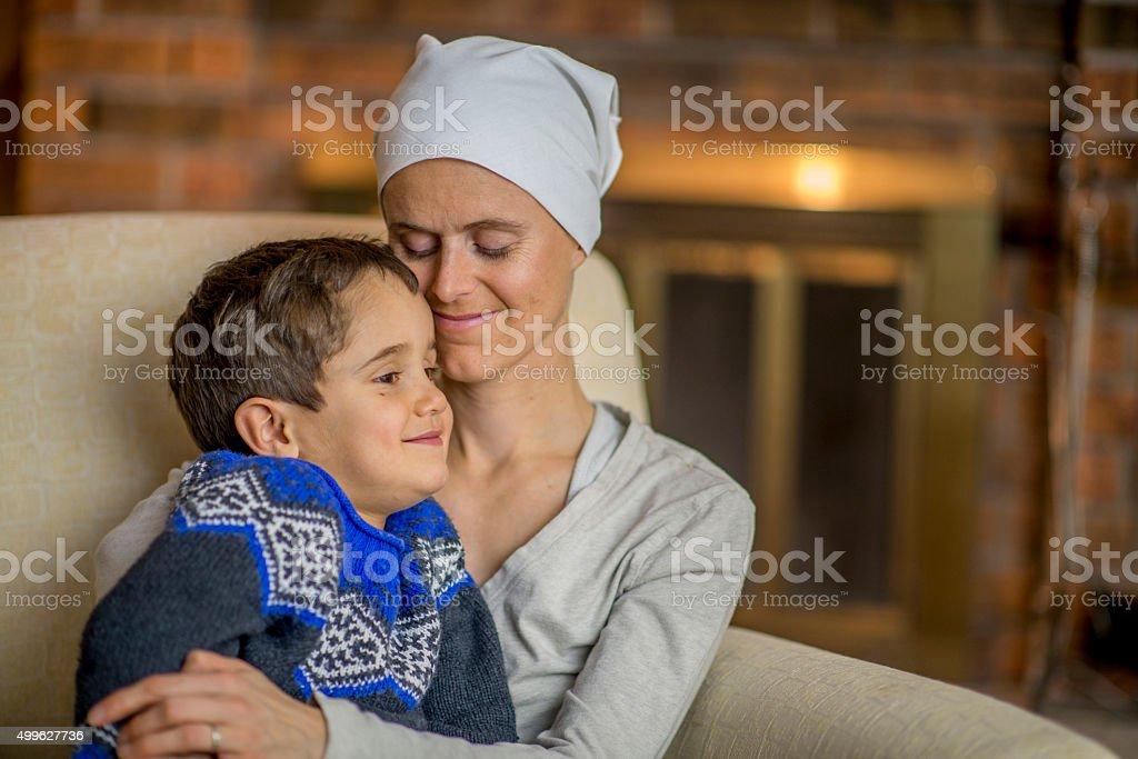 Hopeful Mother Holding Her Little Boy stock photo