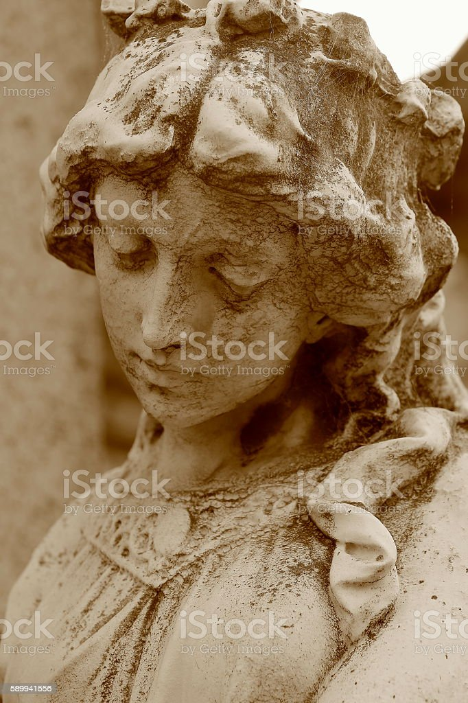 Hopeful Sépia Madonna Angel, sad facial expression, Recoleta Cemetery stock photo