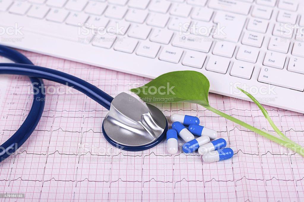 hope:keyboard and stethoscope on electrocardiogram royalty-free stock photo
