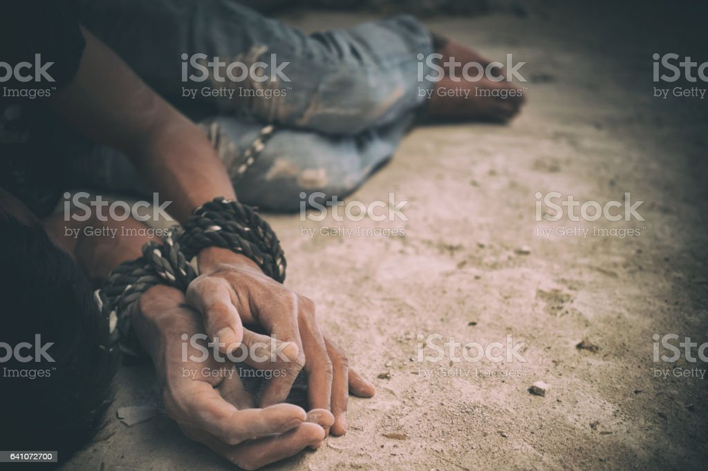 hopeless man hands tied together with rope stock photo
