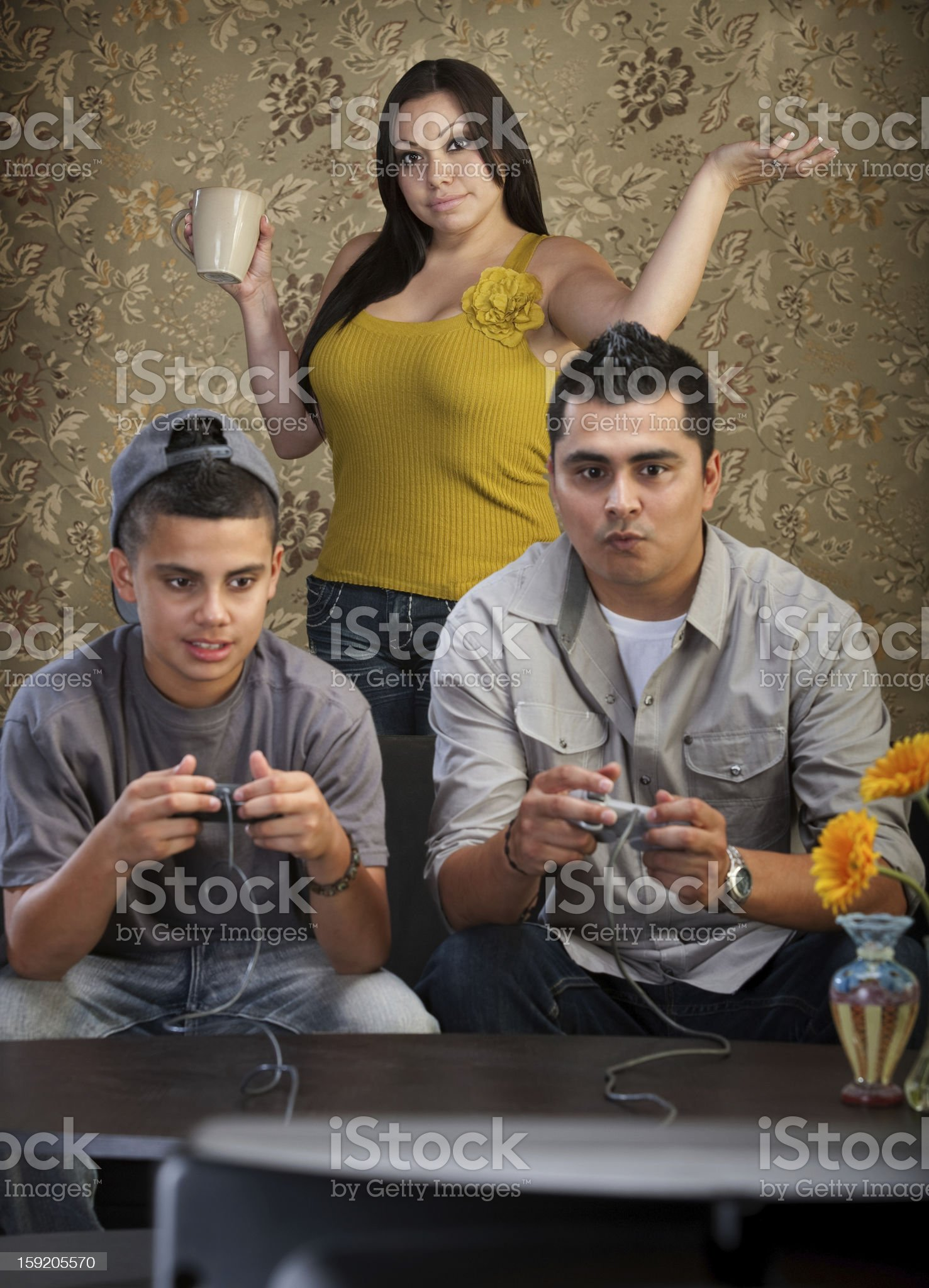 Hopeless Mom with Gamers royalty-free stock photo