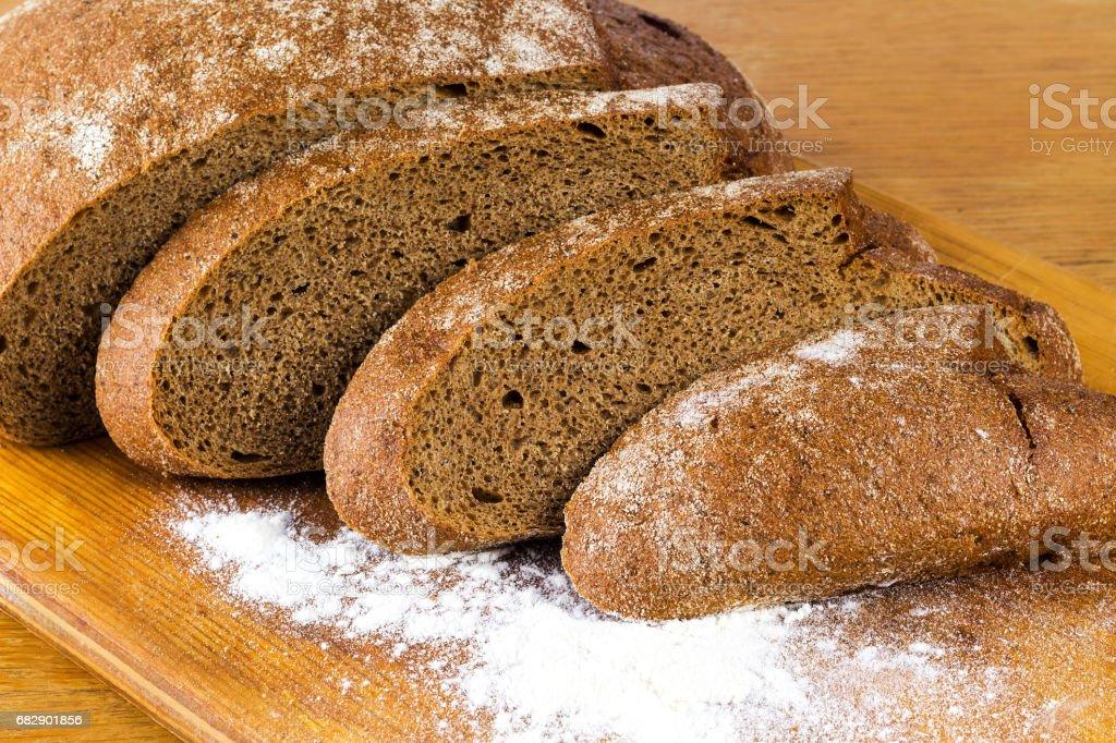 hopped rye bread board stock photo