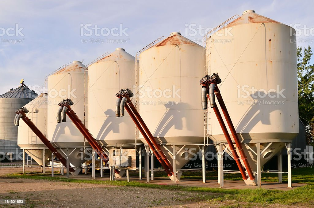Hopper Bottom Grain Bins stock photo