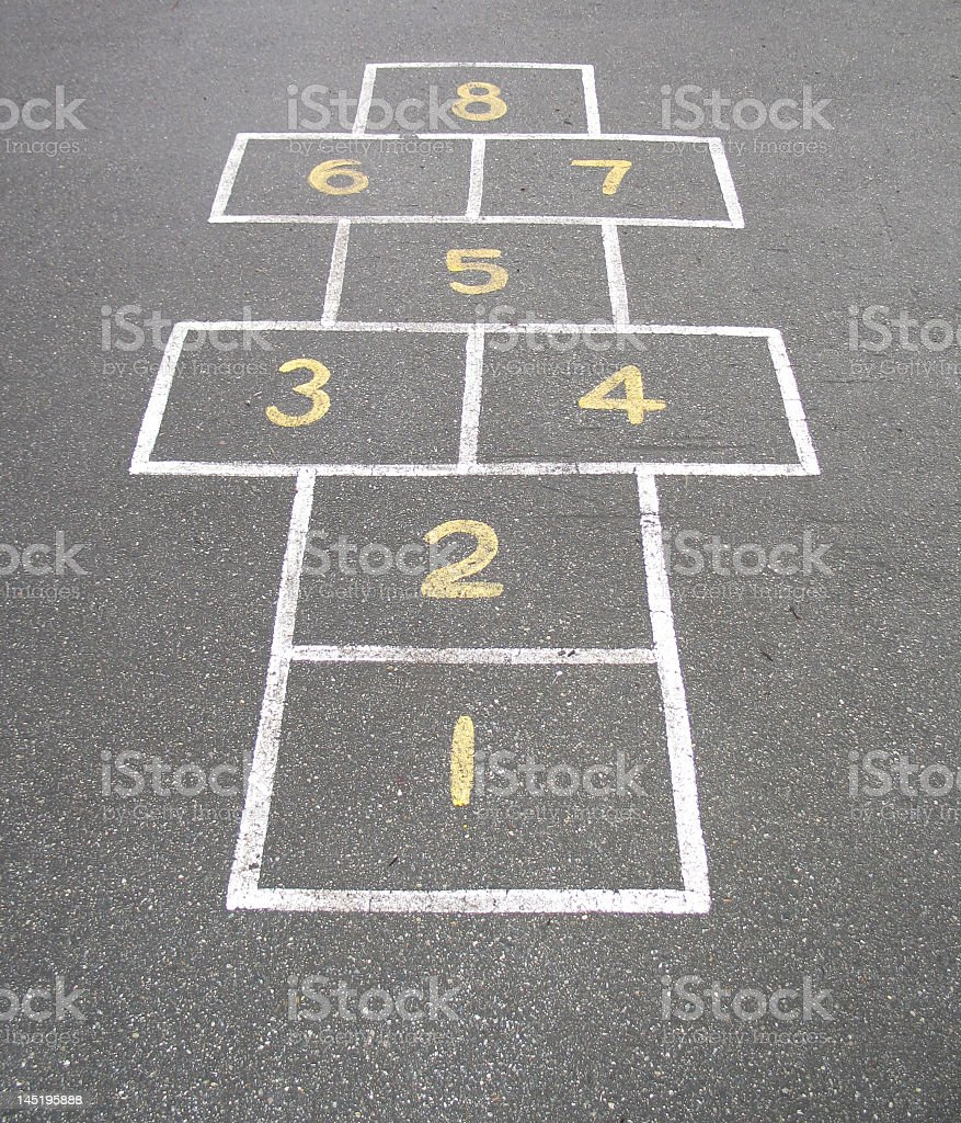 Hopscotch drawn with chalk on concrete with yellow numbers royalty-free stock photo