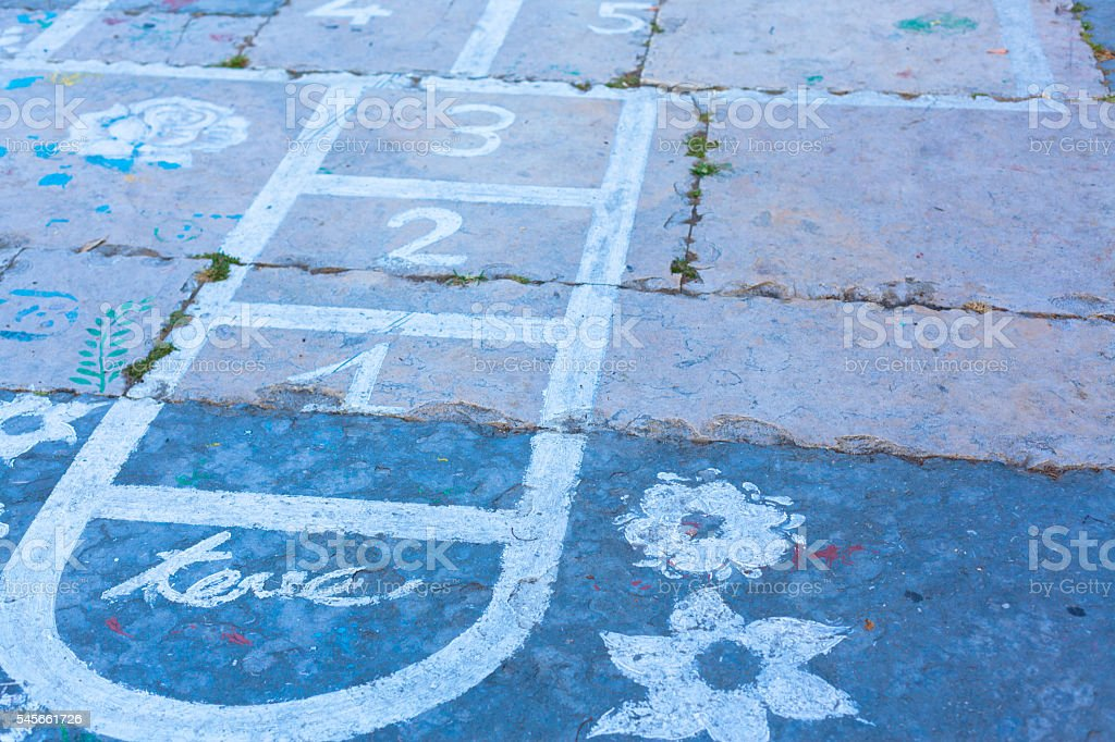 Hopscotch on an asphalt floor with chalk drawings stock photo