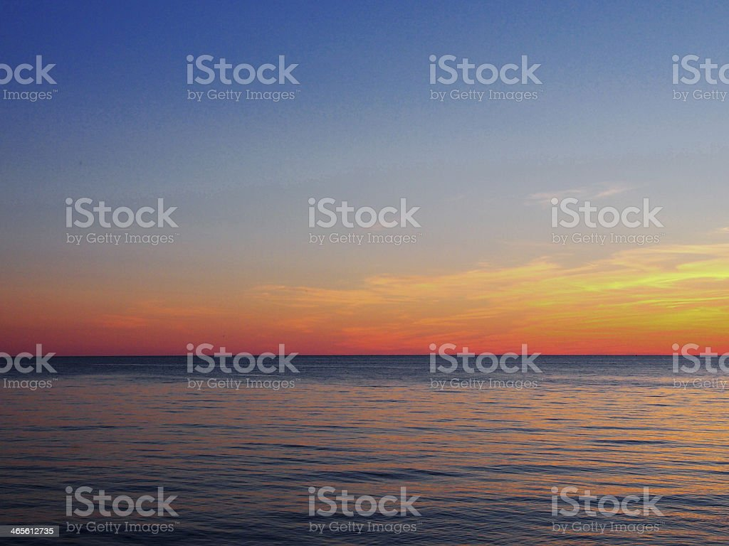 horizon at the sea with afterglow stock photo