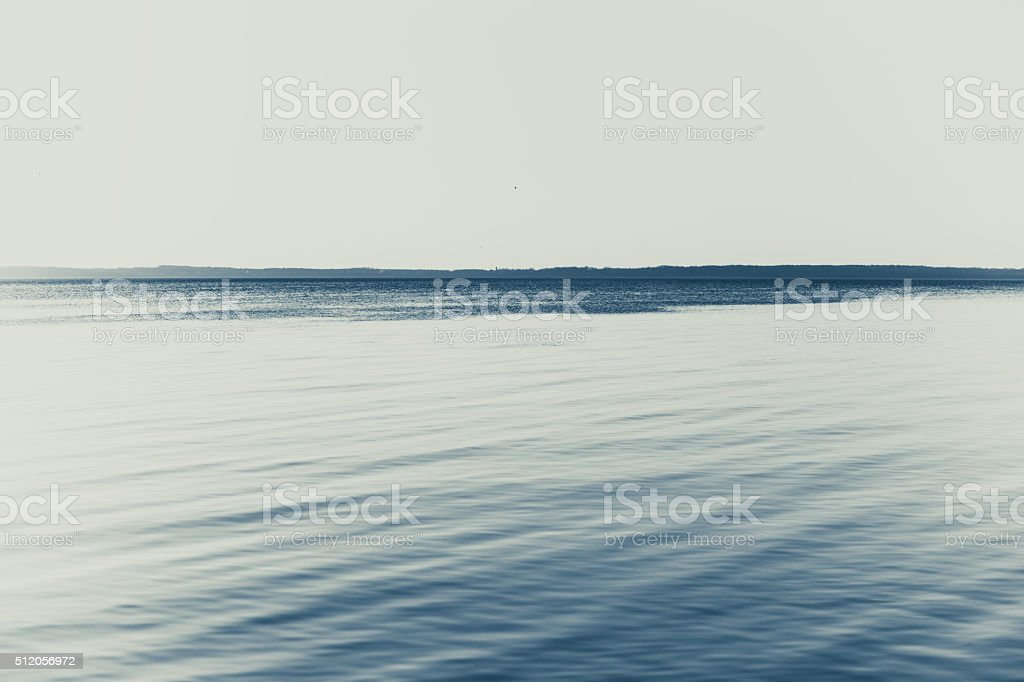 Horizon over water surface stock photo